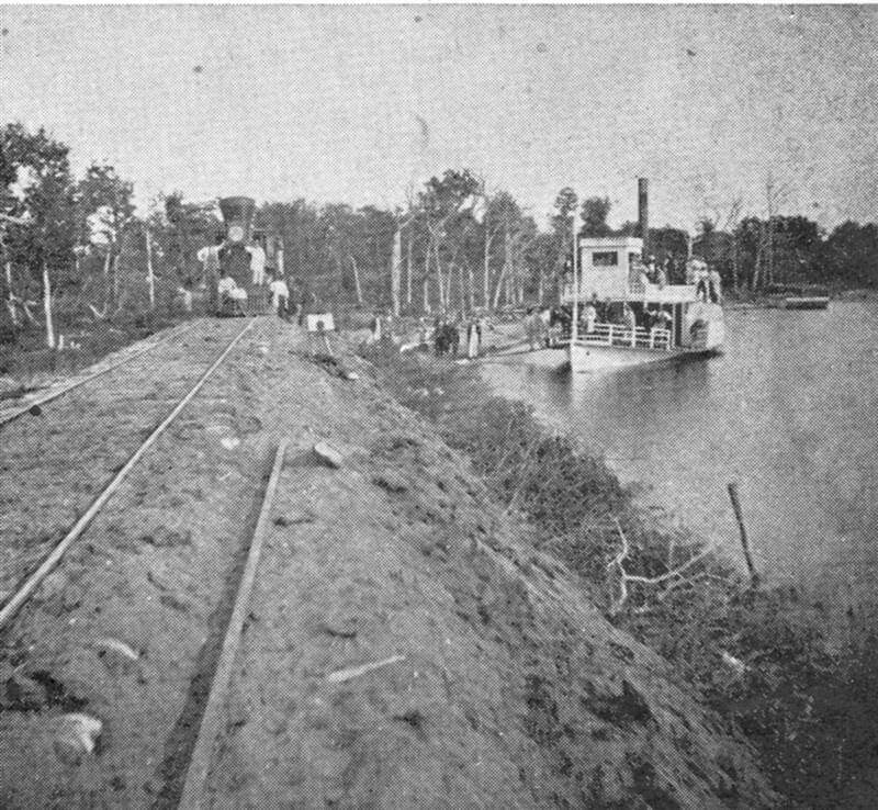 Steam train engine and steam boat at Lake Minnetonka shoreline in early Wayzata, circa 1860.
