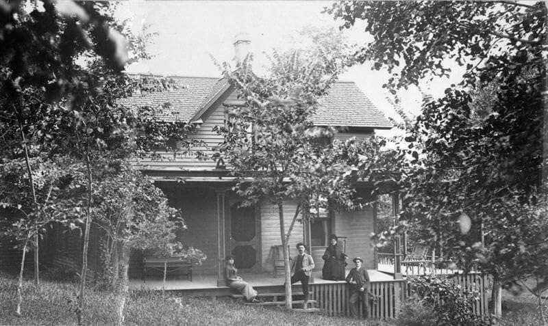 Family on porch of home in Wayzata, circa 1880.