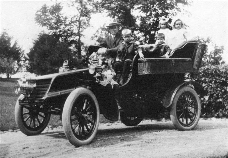 Charles Bovey with kids in automobile. about 1920.