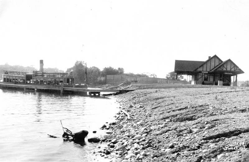 Steamer at dock by train depot on Lake Minnetonka, about 1910