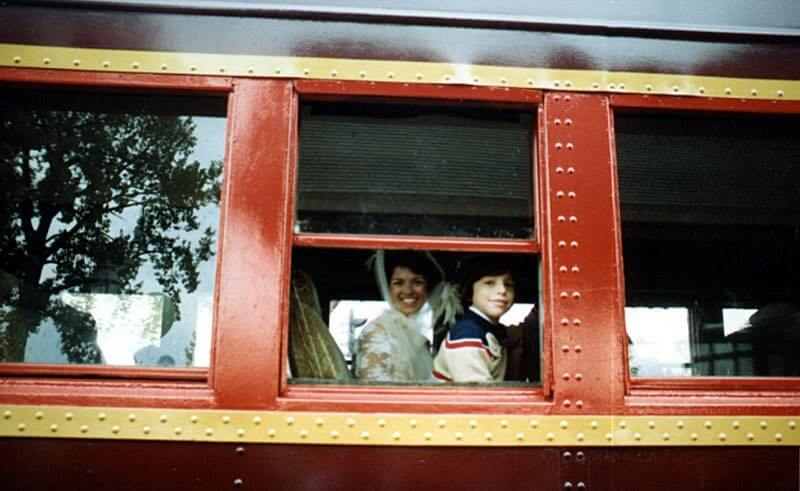 Gaylene Lon and son on steam train at the depot for the 75th anniversary party