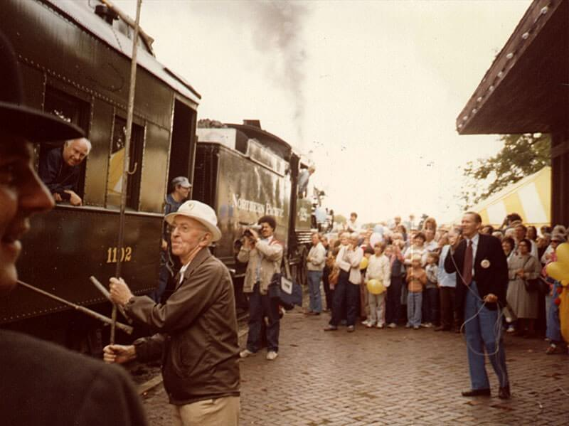 Crowd by train at the 75th anniversary of the Depot's opening